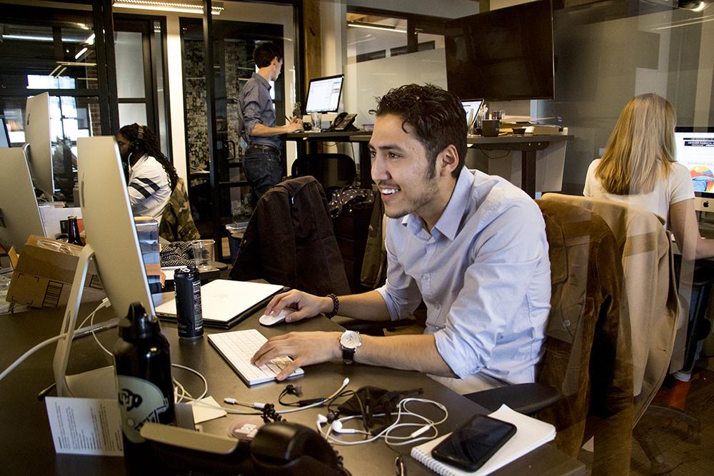 Denverite reporter Esteban L. Hernandez in the newsroom. (Kevin J. Beaty/Denverite)