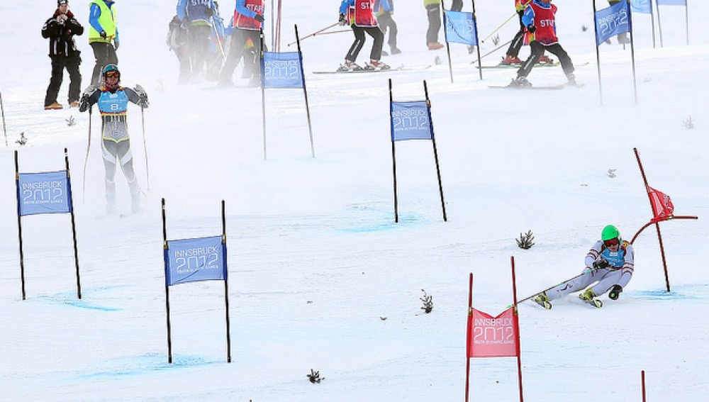 Marco Schwarz (right) of Austria competes as Martin Fjeldberg of Norway reacts during the parallel team final of alpine skiing event at the Innsbruck 2012 Youth Olympic Games in Innsbruck, Austria, Jan 17, 2012. (Courtesy of Li Ming/Xinhua/IOC)