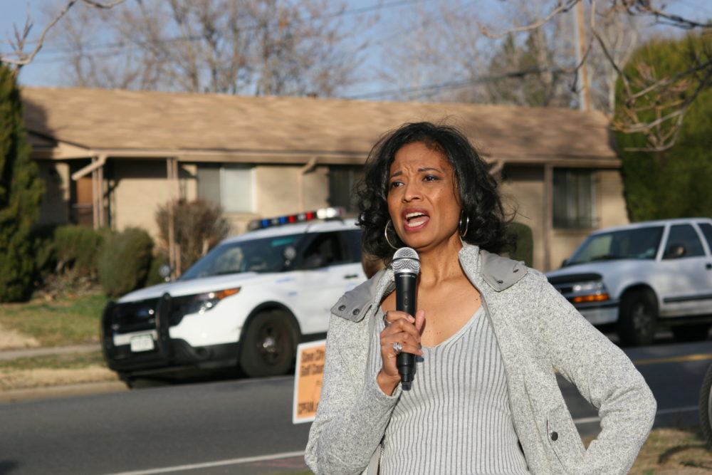 Lisa Calderón speaks at a rally. (Allan Tellis/Denverite)