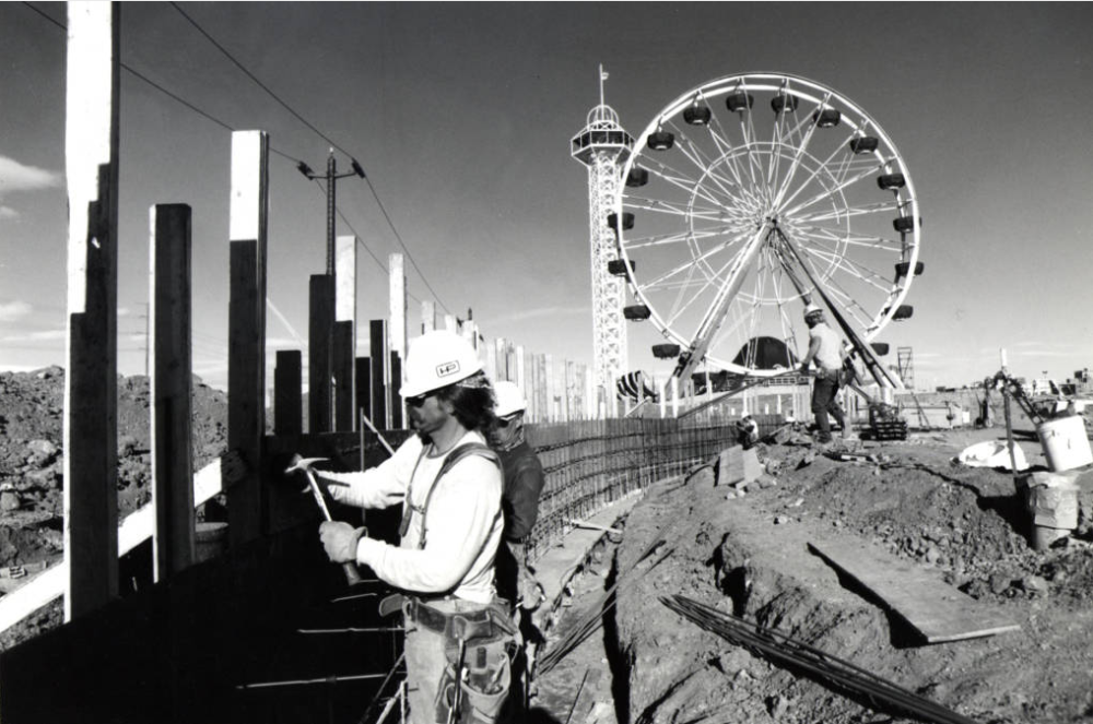 Mike Peak, a carpenter for Hensel Phelps construction, works on concrete forms for the Kiddieland Pond wall, at the new Elitch's. (Steve Groer/Denver Public Library/Western History Collection/RMN-058-9021)