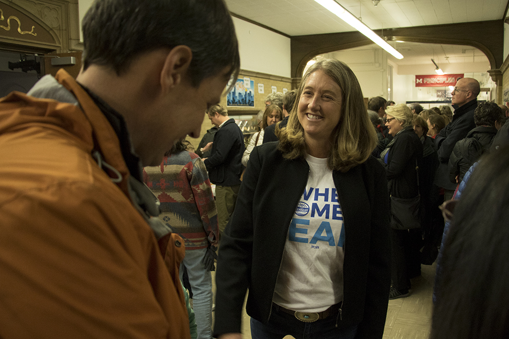 Gubernatorial candidate Cary Kennedy speaks with a constituent before a Democratic Party caucus at Smiley Middle School in North Park Hill, March 6, 2018. (Kevin J. Beaty/Denverite)  copolitics; denver; colorado; northeast park hill; denverite; colorado; kevinjbeaty; election;