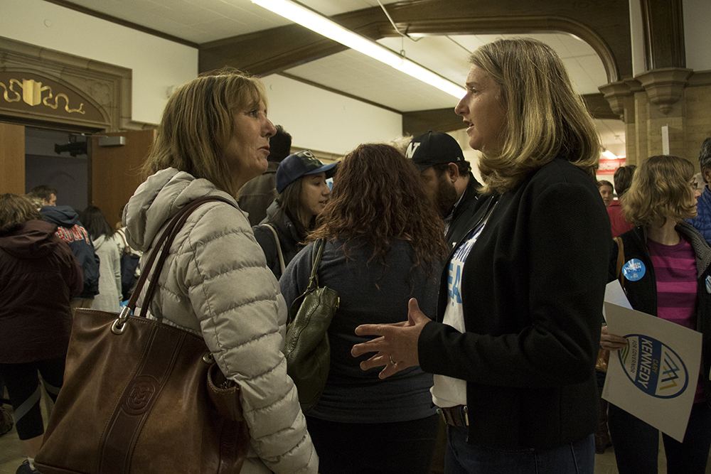Gubernatorial candidate Cary Kennedy speaks with constituent Kristin Winkel before a Democratic Party caucus at Smiley Middle School in North Park Hill, March 6, 2018. (Kevin J. Beaty/Denverite)  copolitics; denver; colorado; northeast park hill; denverite; colorado; kevinjbeaty; election;