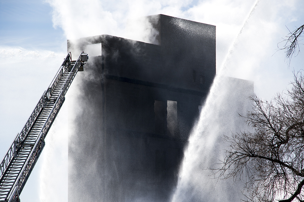 A huge fire is put out near the intersection of 18th Avenue and Emerson Street, March 7, 2018. (Kevin J. Beaty/Denverite)  fire; firefighting; denver; colorado; kevinjbeaty; denverite; uptown; north capitol hill;
