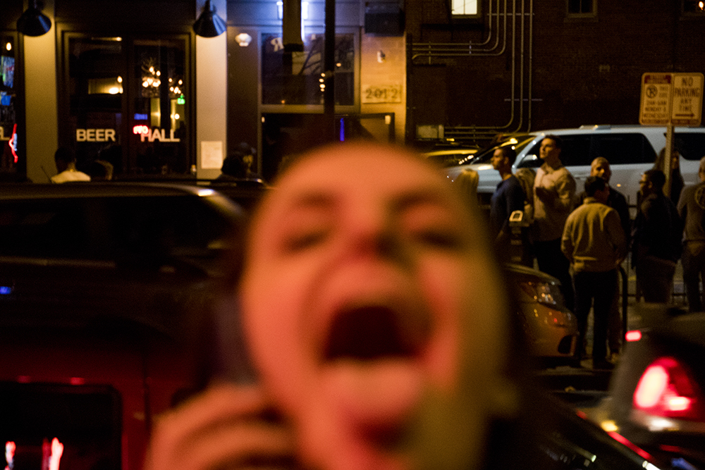 Alena Beard sees a camera and acts fast. Closing time in LoDo, March 12, 2018. (Kevin J. Beaty/Denverite)  nightlife; bars; denver; colorado; denverite; kevinjbeaty; lodo; downtown;