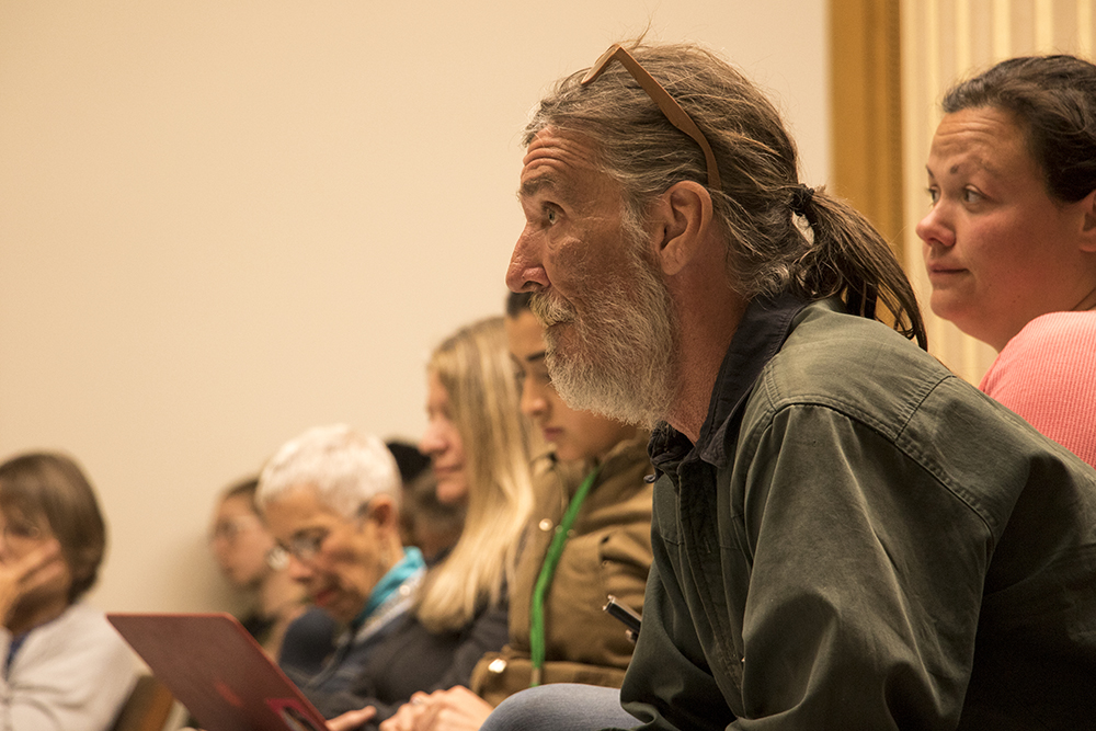 """Ray Lyall listens as a """"right to rest"""" bill is considered by a Colorado State House committee, March 14, 2018. (Kevin J. Beaty/Denverite)  right to rest; homelessness; denver; denverite; kevinjbeaty; copolitics; colorado;"""