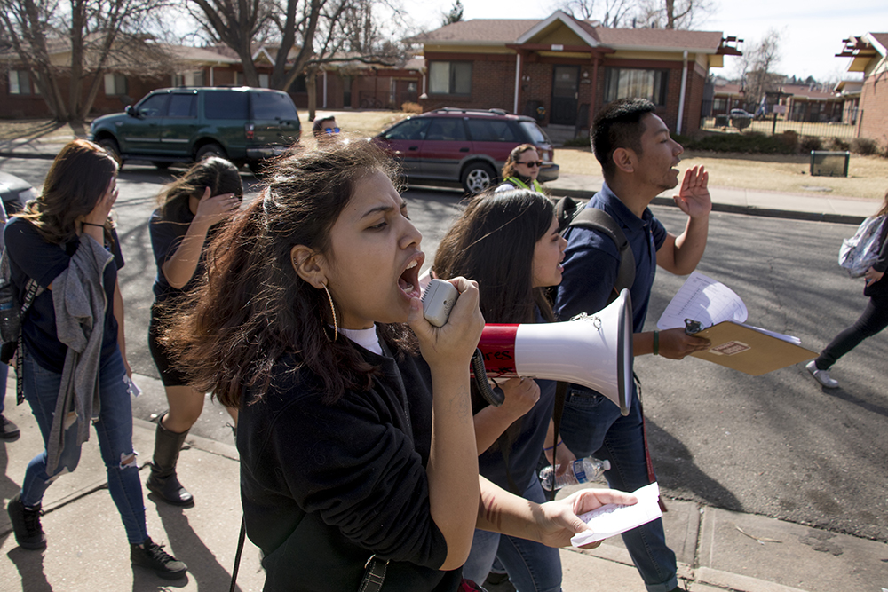 Ilene Orgaz leads chants as students from KIPP Denver Collegiate High School walk out of class as part of a national protest against gun violence, Mach 14, 2018. (Kevin J. Beaty/Denverite)  protest; rally; denver; valverde; denverite; kevinjbeaty; colorado;