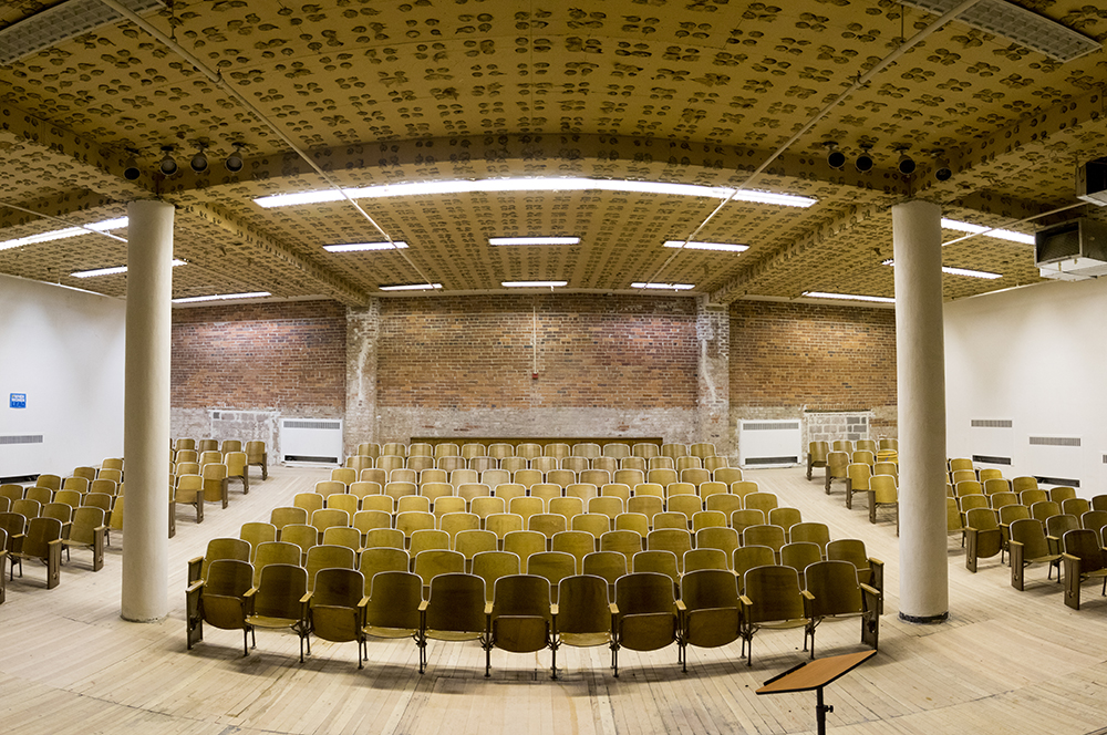 The auditorium inside the historic Evans School building at 11th Avenue and Acoma Street, March 19, 2018. (Kevin J. Beaty/Denverite)