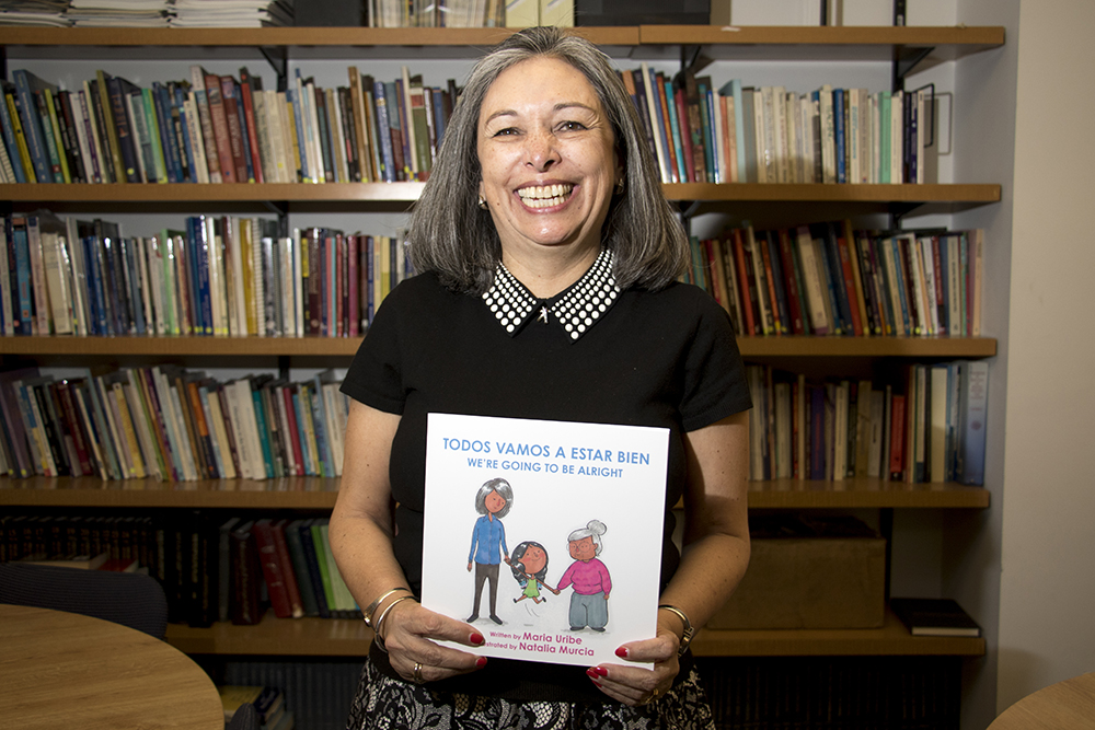 Maria Uribe in a library at the University of Colorado Denver, March 20, 2018. (Kevin J. Beaty/Denverite)  kevinjbeaty; denver; denverite; colorado; author; immigration; books;