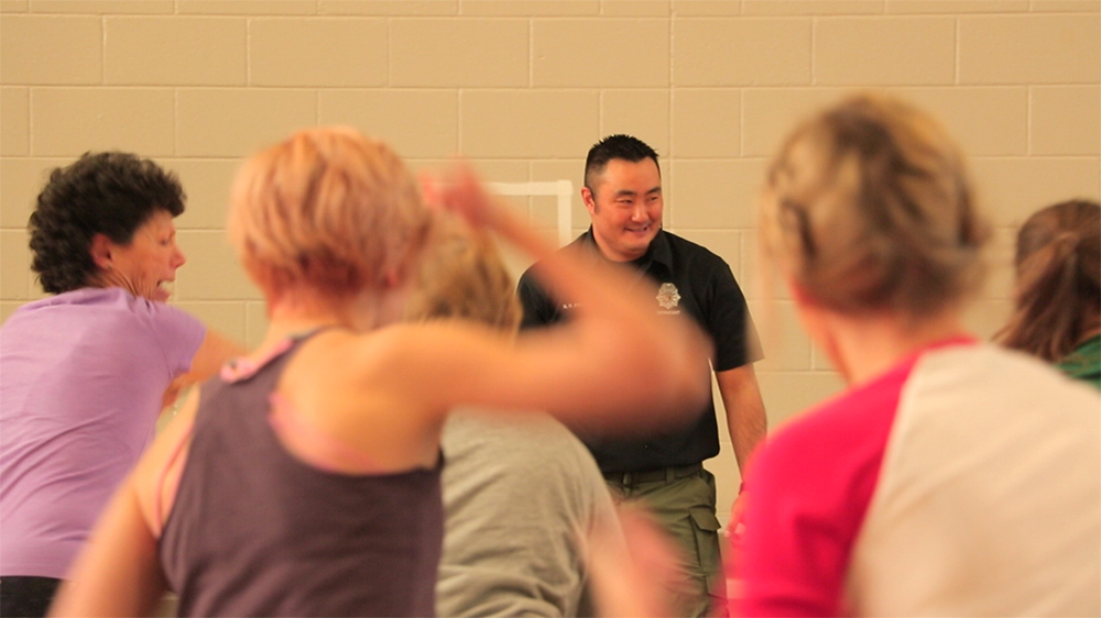 Denver Police Sergeant and 7th-degree black belt Noel Ikeda leads a women's self defense class offered by the Denver Police Department at the Rude Rec Center, March 20,  2018. (Kevin J. Beaty/Denverite)  gym; exercise; karate; martial arts; denver; colorado; rec center; rude rec center; sun valley;
