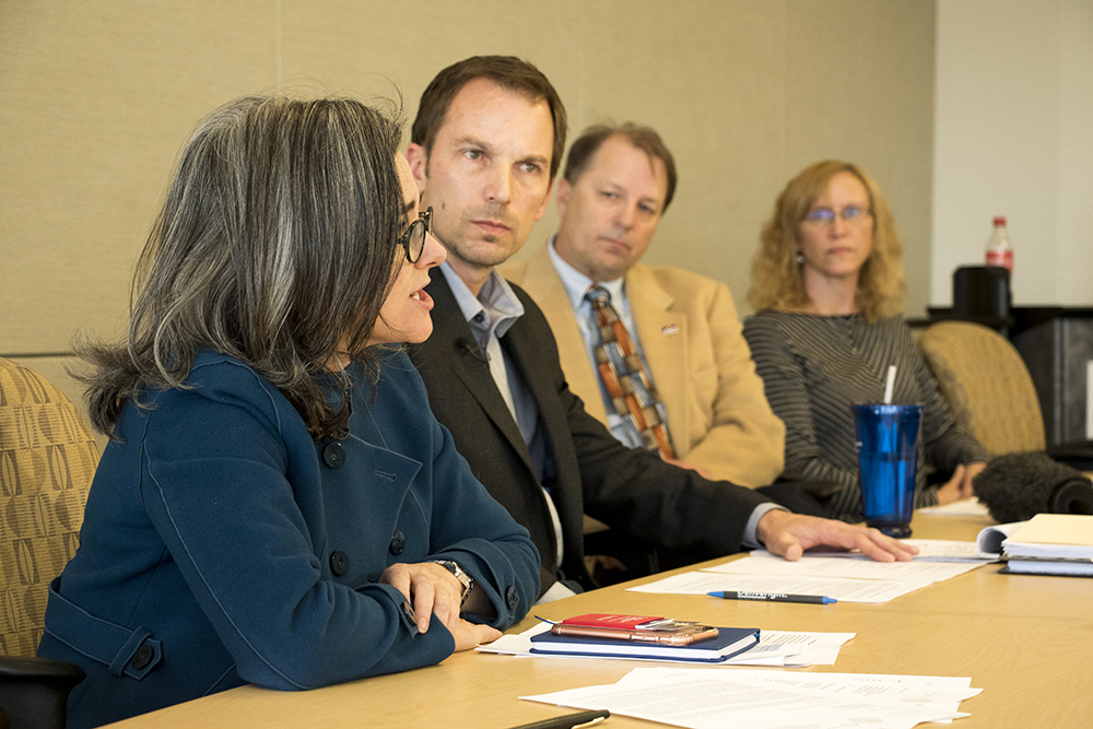 Denver city attorney Kristin Bronson (left to right), spokesman Derek Woodbury and Denver chief economist Jeff Romine speak at press conference concerning compliance in the city's affordable housing program, March 30, 2018. (Kevin J. Beaty/Denverite)  denver; colorado; denverite; kevinjbeaty;