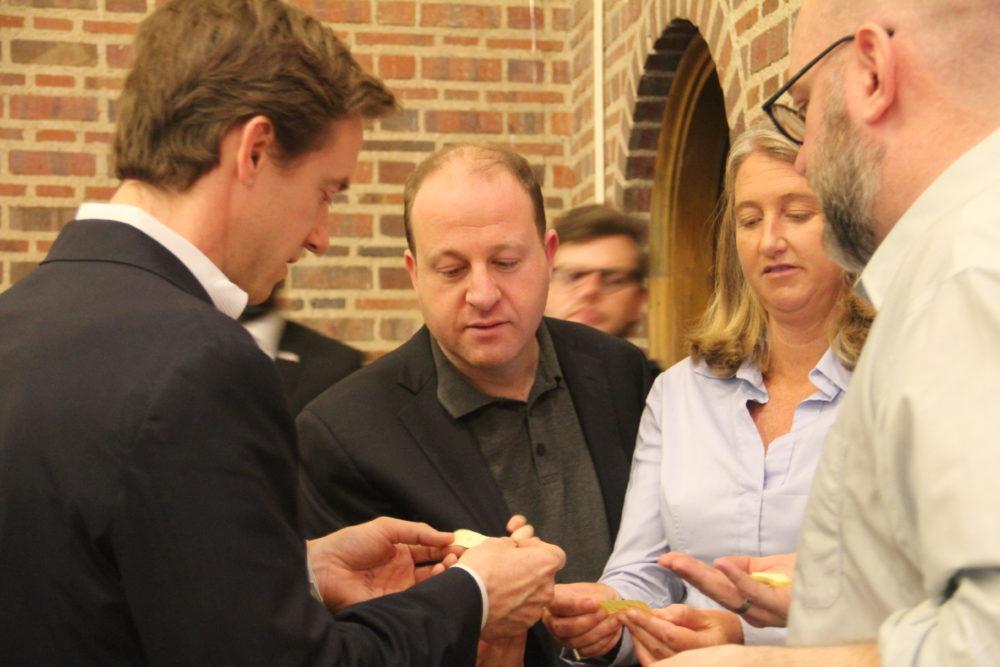 U.S. Rep. Jared Polis (center) looks on w (Esteban L. Hernandez/Denverite)