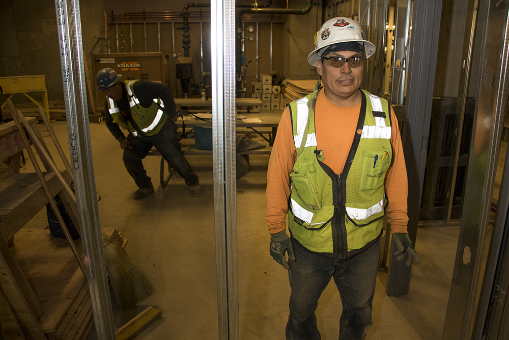 Carpenter Gilbert Begay poses for a portrait at his jobsite in the future Gaylord Rockies Resort and Convention Center, March 22, 2018. (Kevin J. Beaty/Denverite)  denver; colorado; denverite; development; kevinjbeaty; construction;