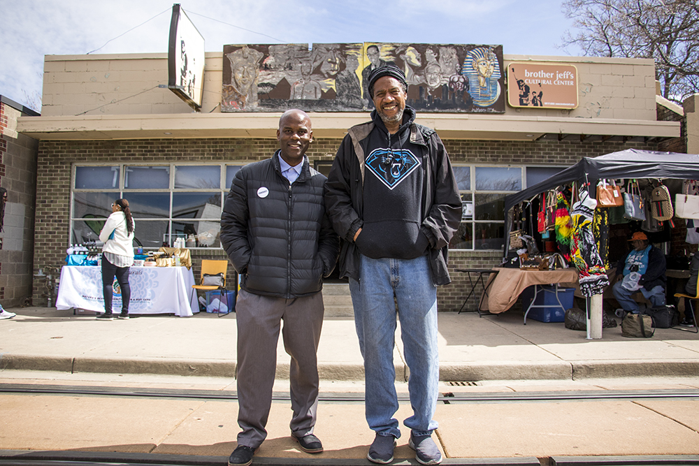 Brother Jeff Fard and Ron Springer stand in front of Black Dollar Saturdays at Brother Jeff's Cultural Center on Welton Street, March 31, 2018. (Kevin J. Beaty/Denverite)  denver; colorado; denverite; kevinjbeaty; five points; brother jeff fard; welton street;