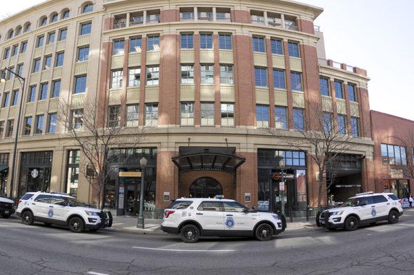 Police cars are parked on Blake Street at the scene of a burglary, April 3, 2018. (Kevin J. Beaty/Denverite)  crime; downtown; denver; police; colorado; kevinjbeaty; denverite;