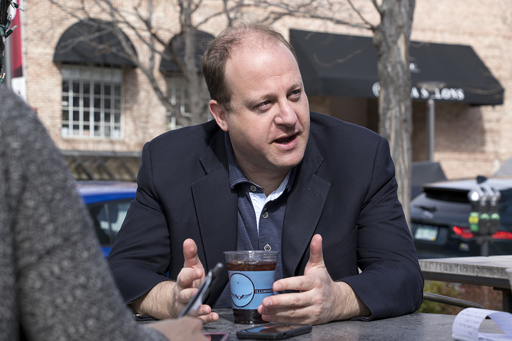 Jared Polis speaks with a reporter at a Cherry Creek coffee shop, April 5, 2018. (Kevin J. Beaty/Denverite)  copolitics; election; denver; colorado; denverite;