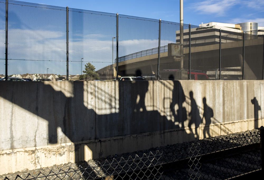Commuters exit RTD's Arapahoe at Village Center station, April 11, 2018. (Kevin J. Beaty/Denverite)