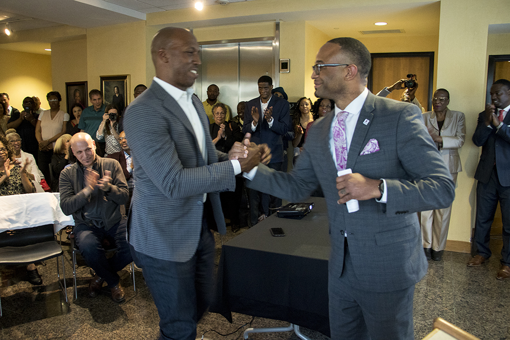 City Council President Albus Brooks (right) shakes hands with NBA star Chauncey Billups. Developers meet with the Five Points community to announce new plans for the Rossonian Hotel. Blair-Caldwell African American Research Library, April 16, 2018. (Kevin J. Beaty/Denverite)  denver; colorado; denverite; five points; development; welton street; kevinjbeaty;