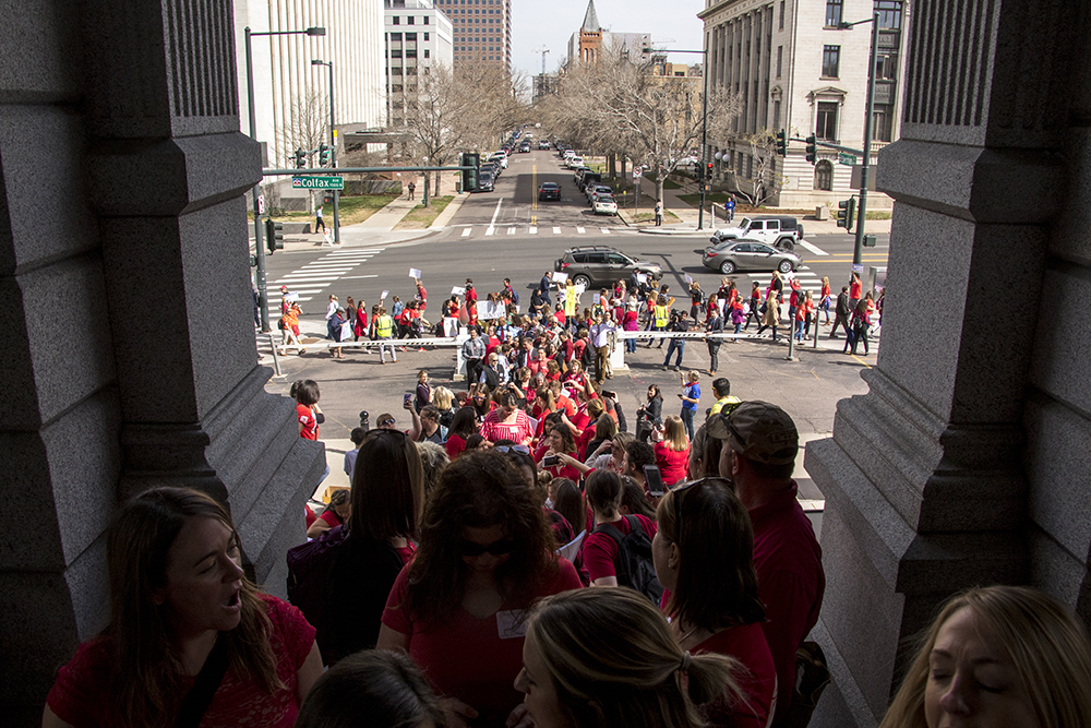 Colorado teachers stream into the State Capitol to protest a lack of school funding, April 16, 2018. (Kevin J. Beaty/Denverite)  denver; colorado; protest; education; teacher strike; denverite; kevinjbeaty; teachers;