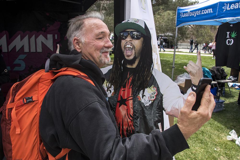 Joe Grissom from Wisconsin takes a selfie with a Lil Jon cutout. Denver's 2018 Mile High 420 Festival, April 20, 2018. (Kevin J. Beaty/Denverite)  420; stoner; denver; denverite; colorado; kevinjbeaty;