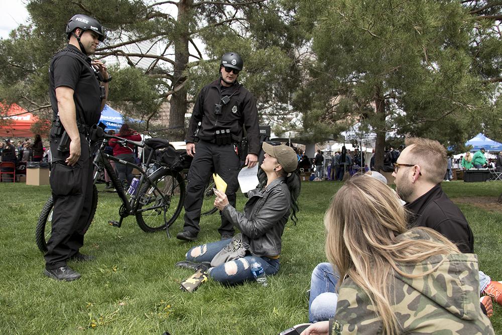 Denver Police officers write public consumption tickets. Denver's 2018 Mile High 420 Festival, April 20, 2018. (Kevin J. Beaty/Denverite)  420; stoner; denver; denverite; colorado; kevinjbeaty;