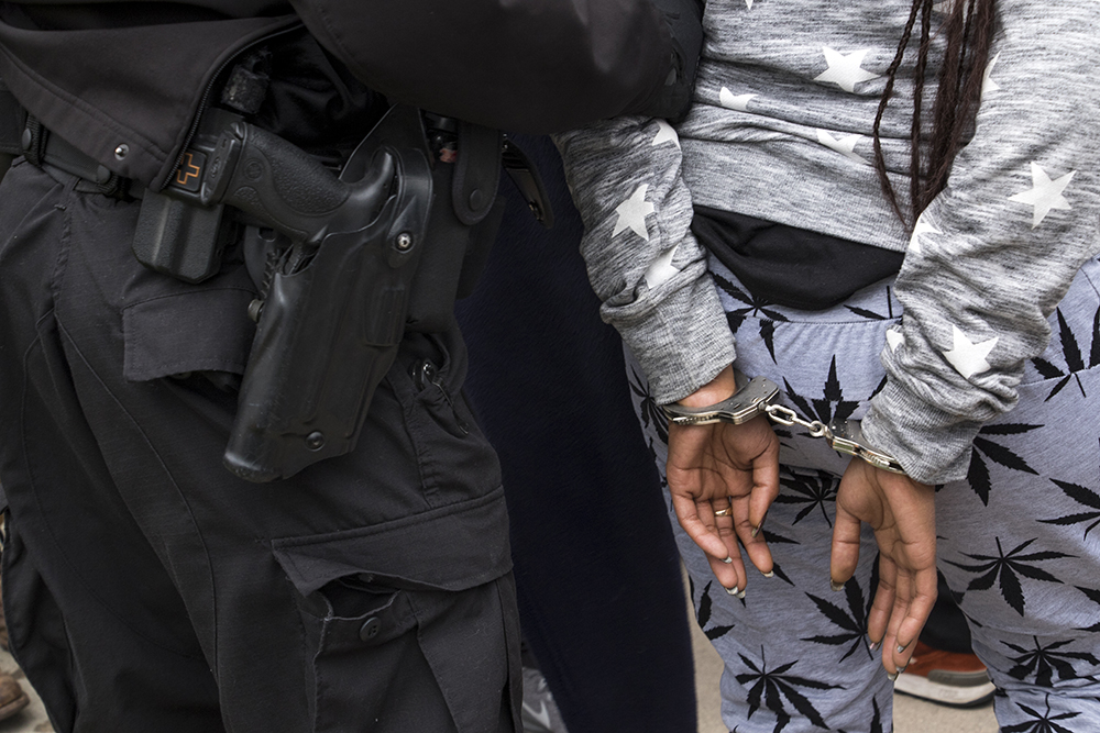 Police arrest two people, allegedly for illegal gambling activity, during Denver's 2018 Mile High 420 Festival, April 20, 2018. (Kevin J. Beaty/Denverite)