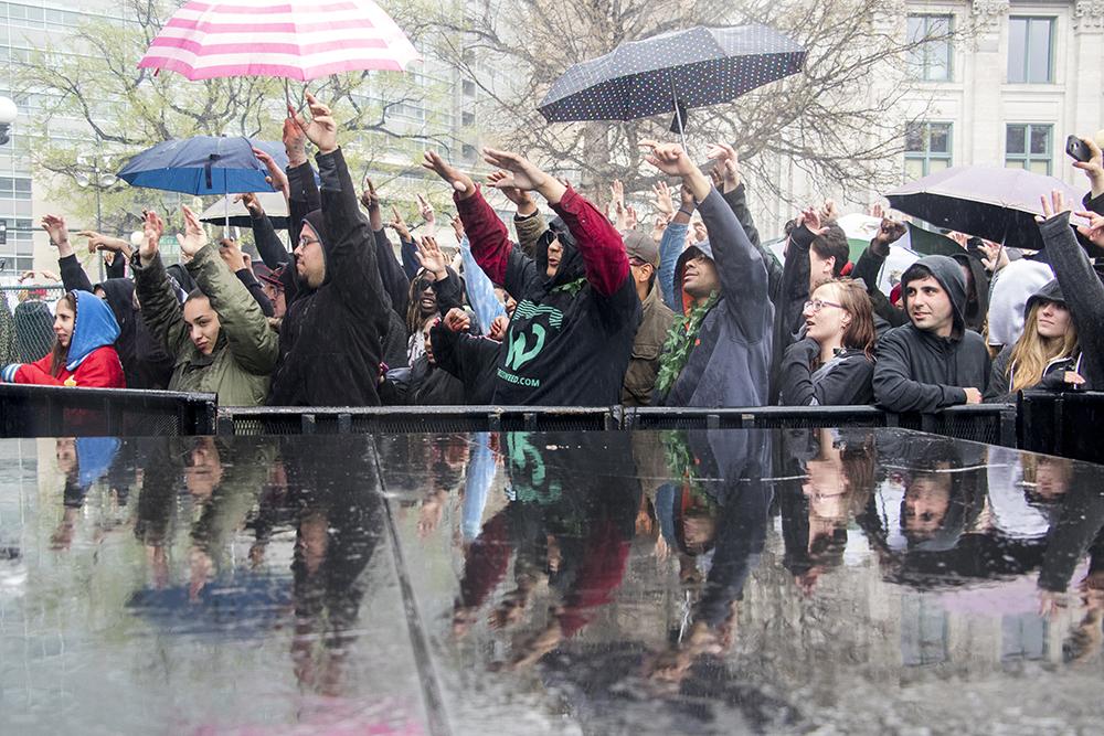 Rain falls over Denver's 2018 Mile High 420 Festival, April 20, 2018. (Kevin J. Beaty/Denverite)  420; stoner; denver; denverite; colorado; kevinjbeaty;