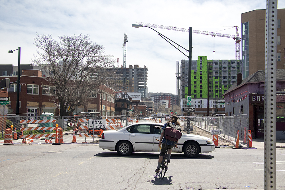 The future site of a bike lane between Champa Street and Broadway that will be part of the 5280 Loop, April 23, 2018. (Kevin J. Beaty/Denverite)