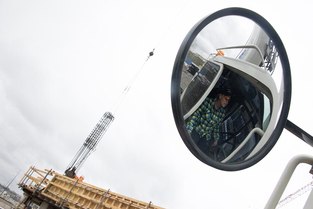 Stephanie Miller operates a crane on a build site at Denver Water's headquarters in the Lincoln Park neighborhood, April 24, 2018. (Kevin J. Beaty/Denverite)  la alma; lincoln park; construction; development; denver water; denverite; kevinjbeaty; colorado;