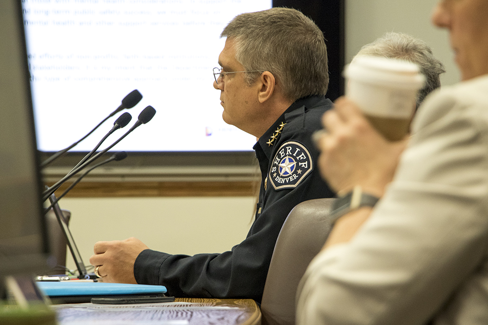 Denver Sheriff Patrick Firman listens as Denver City Council meets with the Department of Safety regarding Michael Marshall's death in police custody in 2015, April 25, 2018. (Kevin J. Beaty/Denverite)  denver; colorado; denver city council; denverite; denver Department of Safety; kevinjbeaty;