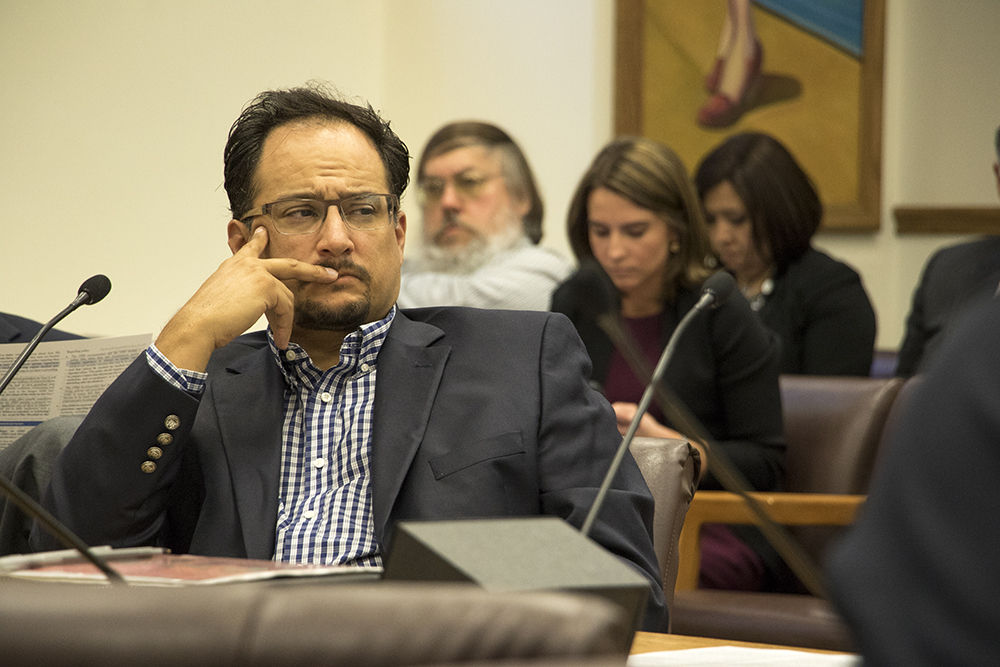 District 1 City Councilman Raphael Espinoza listens as Denver City Council meets with the Department of Safety regarding Michael Marshall's death in police custody in 2015, April 25, 2018. (Kevin J. Beaty/Denverite)