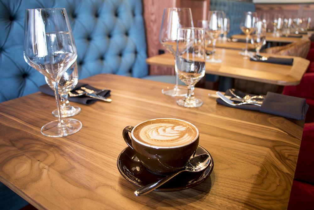 A latte on the bar at the Dead Battery Club on Platte Street, April 26, 2018. (Kevin J. Beaty/Denverite)  denver; colorado; denverite; kevinjbeaty; food; bars; nightlife; highland;