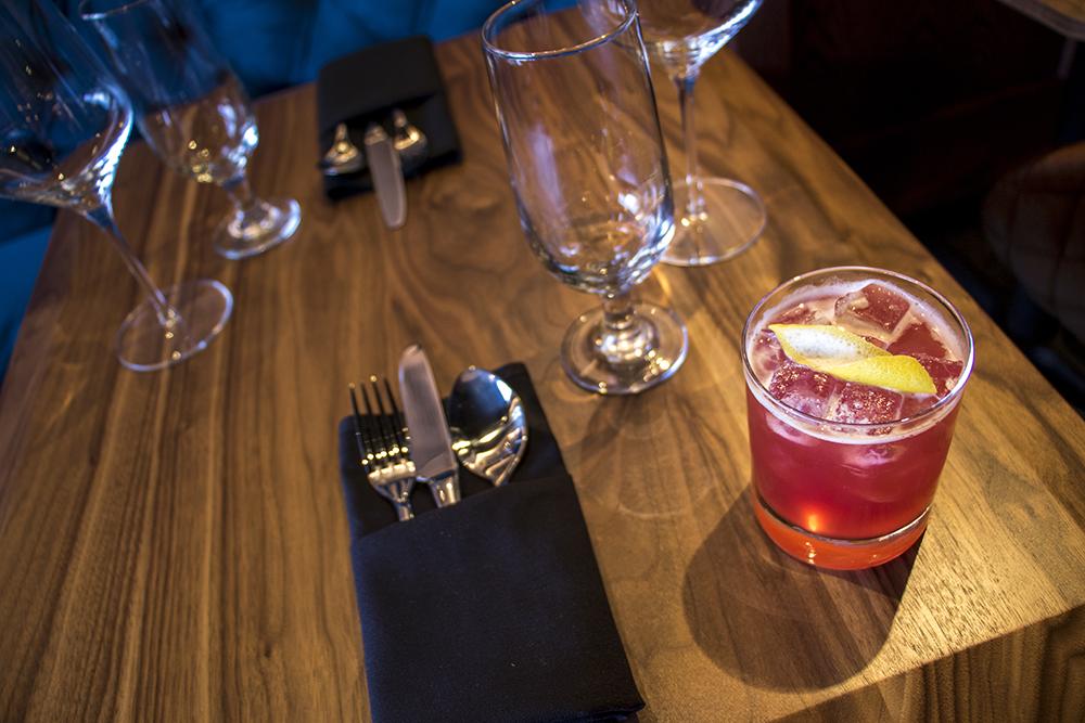 We (Don't) Work, Scotch, lemon, hibiscus flower syrup, soda and a lemon twist. Dead Battery Club on Platte Street, April 26, 2018. (Kevin J. Beaty/Denverite)  denver; colorado; denverite; kevinjbeaty; food; bars; nightlife; highland;