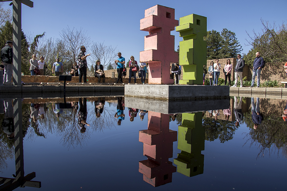 "Artist Mike Whiting gives a tour of his new exhibit, Pixelated, at the Denver Botanic Gardens, April 27, 2018. These are ""Pinky"" and ""Mr. Green."" (Kevin J. Beaty/Denverite)  art; sculpture; denver botanic gardens; dbg; colorado; denver; denverite; kevinjbeaty;"