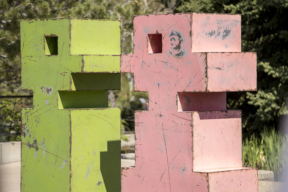 """Pinky"" and ""Mr. Green"" by Artist Mike Whiting features a lot of wear and tear. Pixelated, at the Denver Botanic Gardens, April 27, 2018. (Kevin J. Beaty/Denverite)  art; sculpture; denver botanic gardens; dbg; colorado; denver; denverite; kevinjbeaty;"