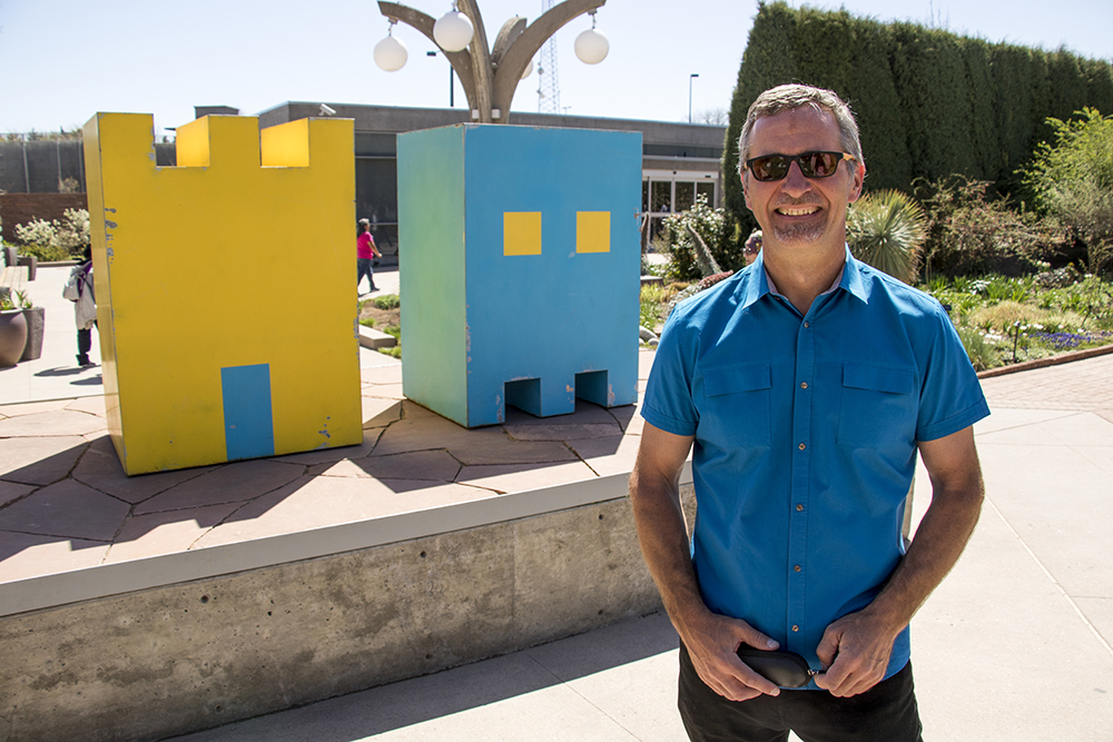 "Denver art collector Ivar Zeile poses for a portrait in front of artist Mike Whiting's works ""Castle"" and ""Ghost"" on display at the Denver Botanic Gardens, April 27, 2018. (Kevin J. Beaty/Denverite)  art; sculpture; denver botanic gardens; dbg; colorado; denver; denverite; kevinjbeaty;"