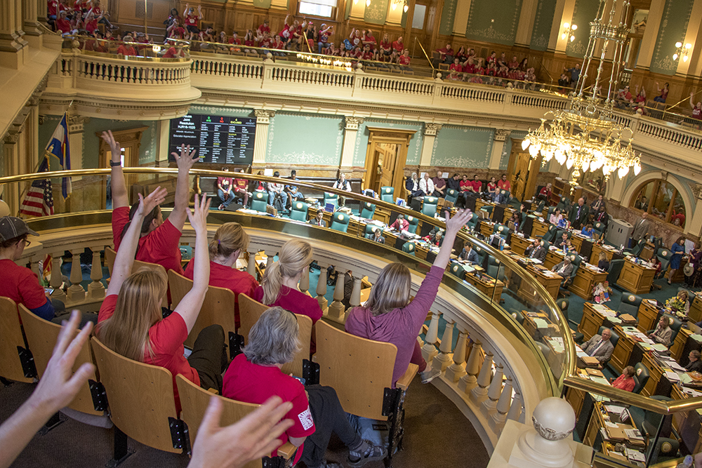 Protesters watch the state House of Representatives on a day of protest of a lack of funding for schools, April 27, 2018. (Kevin J. Beaty/Denverite)  redfored; education; teachers; protest; denver; colorado; denverite; kevinjbeaty;