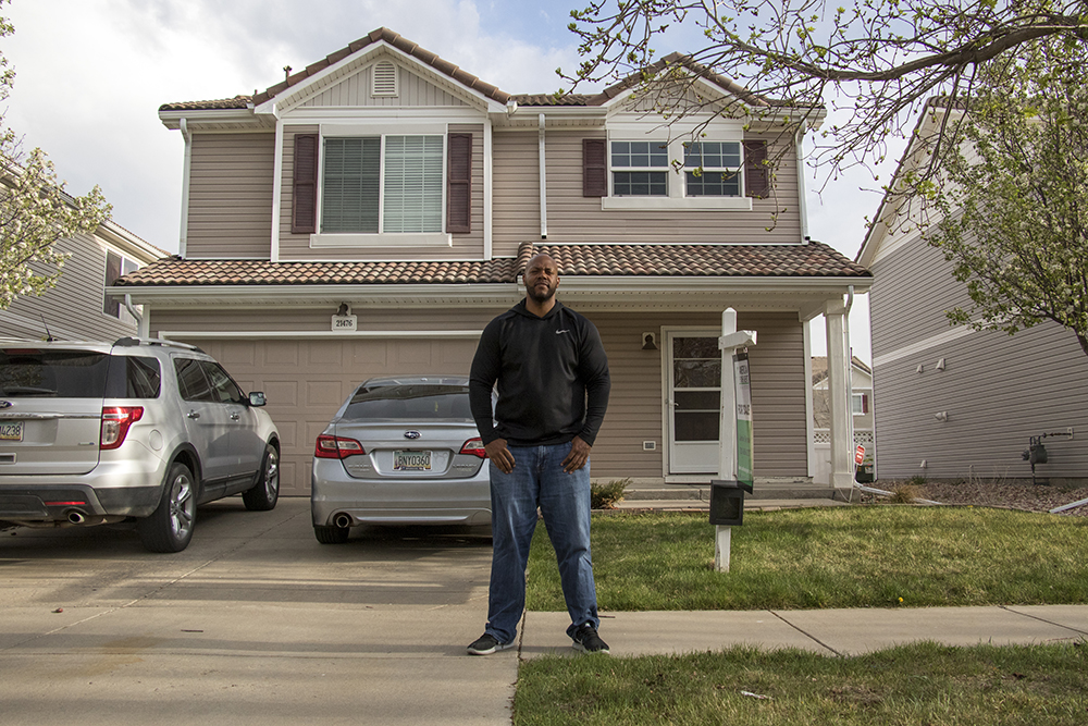 Marcus Brockman poses for a portrait in front of his Green Valley Ranch home, April 30, 2018. (Kevin J. Beaty/Denverite)  denver; denverite; colorado; green valley ranch; residential real estate; kevinjbeaty;