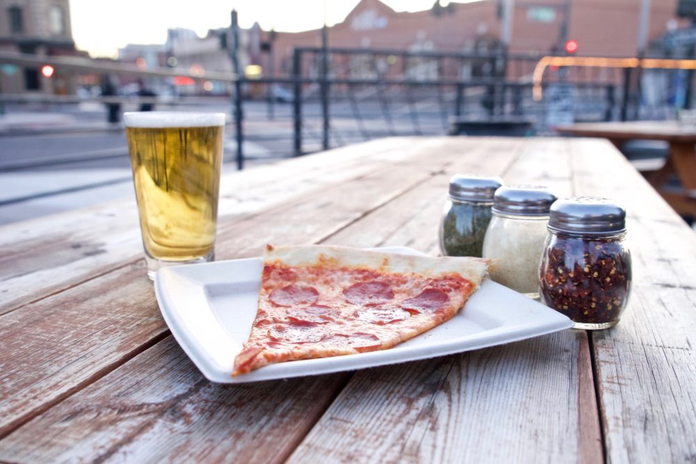 A pepperoni slice from Famous Original J's on the patio at the 715 Club. (Photo: Kevin Galaba)