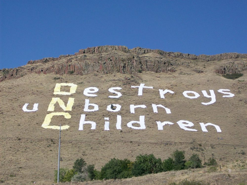 An abortion protest sign on North Table Mountain outside Denver during the 2008 Democratic National Convention. (Rachel Troyer/public domain)