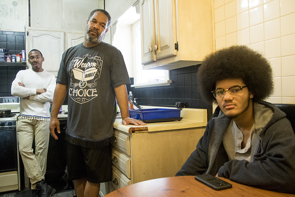 Elijah Beauford (right to left), his dad, Lonnie, and Ashton Kynard, who's living here in their house. April 23, 2018. (Kevin J. Beaty/Denverite)  denver; colorado; denverite; kevinjbeaty;