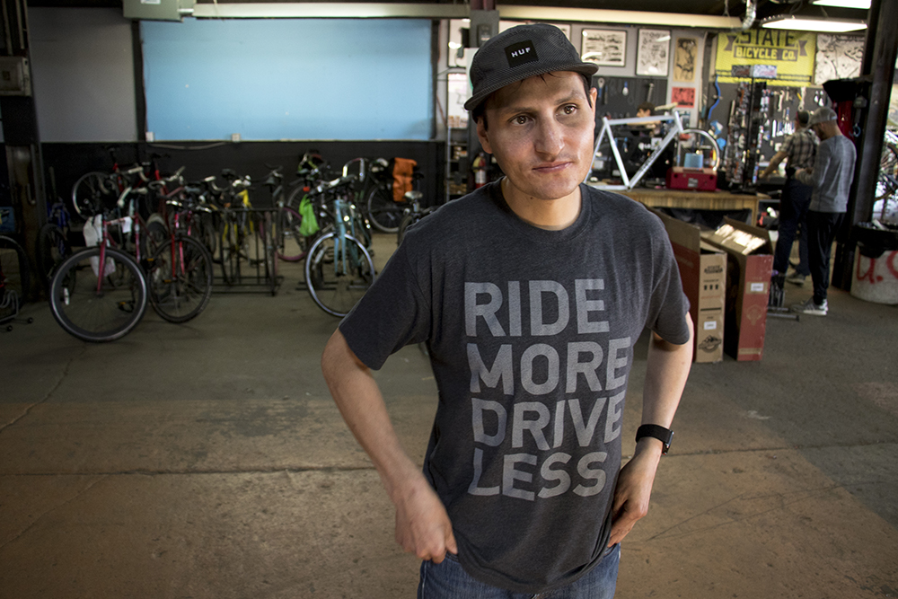 Urban Cyclist owner Darrin Duran in his Brighton Boulevard storefront, May 4, 2018. (Kevin J. Beaty/Denverite)  rino; five points; denver; colorado; denverite; kevinjbeaty; bike shop; bicycle; bikes;
