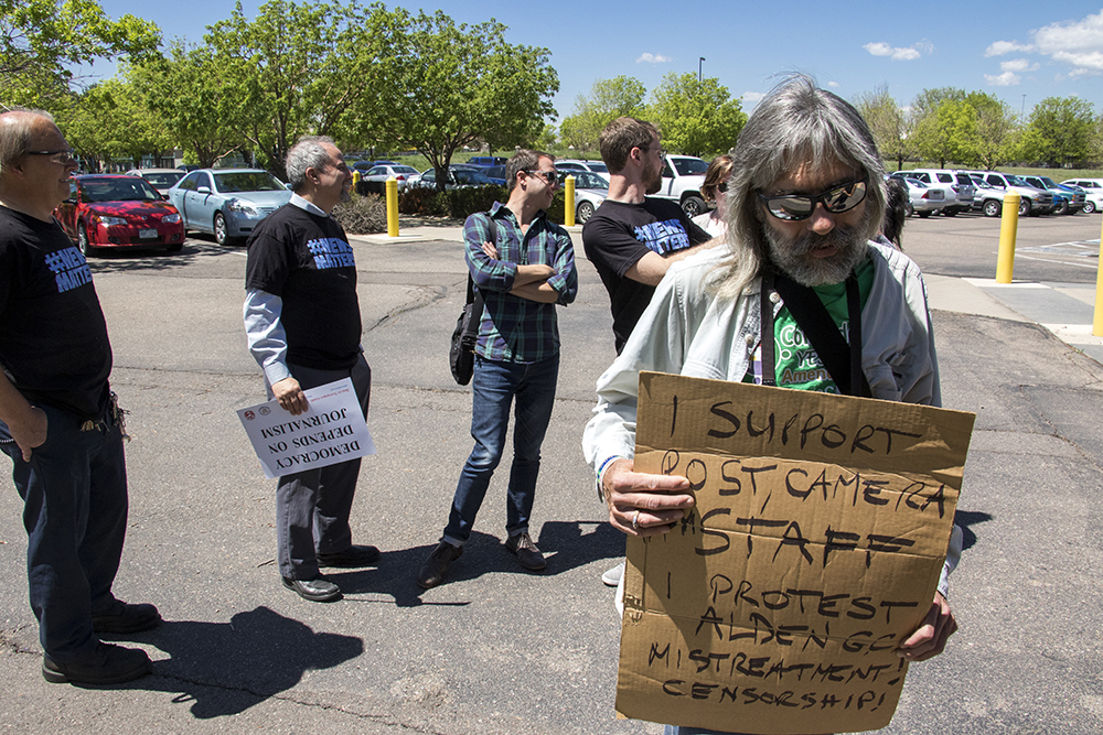 Doug Grinbergs, a Louisville resident, came out to support Denver Post employees who walked out of their Adams Country headquarters in protest their corporate owners, Alden Global Capital, May 8, 2018. (Kevin J. Beaty/Denverite)  denver post; protest; newsmatters; alden global capitol; denver; colorado; denverite; adams county;