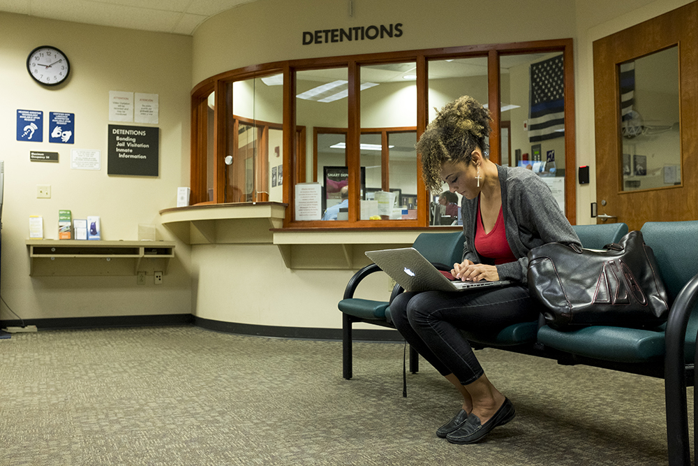 Elisabeth Epps waits inside the Douglas County Jail in Castle Rock to receive the first woman bailed out for Mother's Day as part of a grassroots action backed by Black Lives Matter 5280 and the Denver Justice Project, May 10, 2018. (Kevin J. Beaty/Denverite)