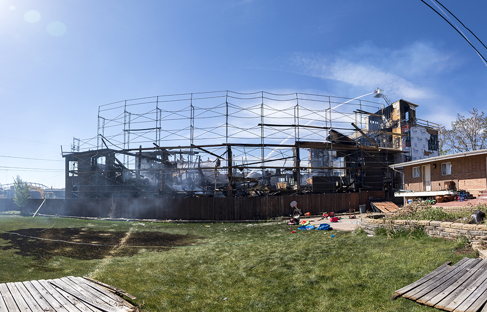 The Denver Fire department sprays water on a construction site that burned down at 1930 Grove Street, May 10, 2018. (Kevin J. Beaty/Denverite)  denver; colorado; denverite; kevinjbeaty; firefighting; fire; construction;