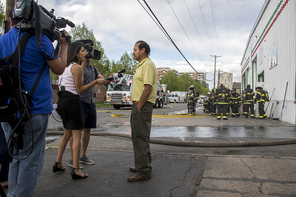 Natanael Chavez, an employee, speaks to press after Tortillas Mexico caught fire on Thursday evening, May 10, 2018. (Kevin J. Beaty/Denverite)  denver; colorado; denverite; lincoln park; fire; firefighting; kevinjbeaty;