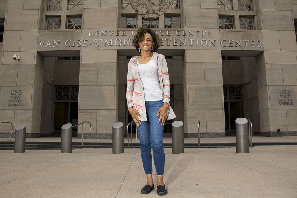 Elisabeth Epps poses for a portrait in front of the Van Cise-Simonet Detention Center downtown, May 11, 2018. (Kevin J. Beaty/Denverite)