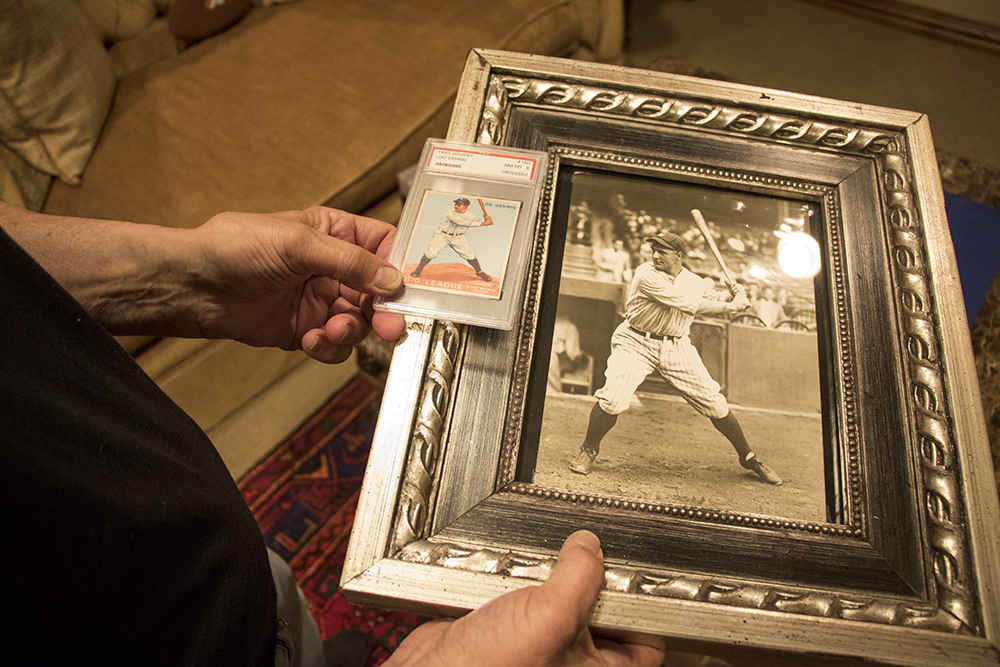 Marshall Fogle holds an original photo of Lou Gehrig and its corresponding German-ink-printed card in his home, a shrine to baseball memorabilia, May 17, 2018. (Kevin J. Beaty/Denverite)  denver; colorado; denverite; baseball; sports; collecting; collector; kevinjbeaty;
