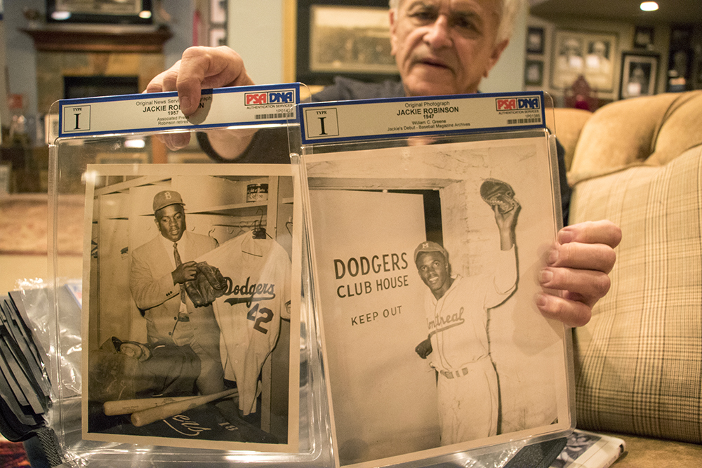 Jackie Robinson on his first (right) and last games. Marshall Fogle in his home, a shrine to baseball memorabilia, May 17, 2018. (Kevin J. Beaty/Denverite)denver; colorado; denverite; baseball; sports; collecting; collector; kevinjbeaty;