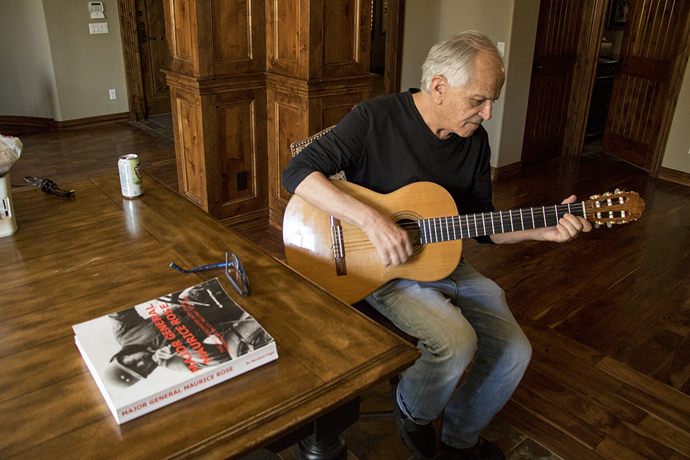 Marshall Fogle plays the guitar in his home, May 17, 2018. (Kevin J. Beaty/Denverite)  denver; colorado; denverite; baseball; sports; collecting; collector; kevinjbeaty;