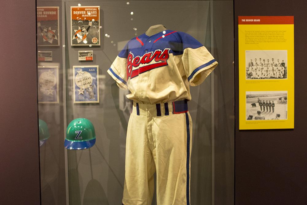 "A Denver Bears uniform and a Denver Zephyrs helmet loaned by Marshall Fogle for ""Play Ball!,"" the new special exhibit at the History Colorado Center, May 17, 2018. (Kevin J. Beaty/Denverite)  denver; colorado; denverite; history colorado center; baseball; sports; kevinjbeaty;"